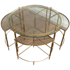 MAISON BAGUÉS. ROUND BRASS COFFEE TABLE WITH NEST