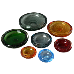 A collection of hand blown coloured glass Whitefriars ashtrays