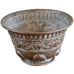 A large metal bowl in Ancient Persian style