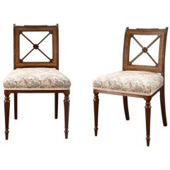A pair of Regency dining chairs