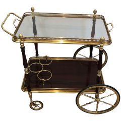 MAISON BAGUÉS. MAHOGANY AND BRASS DRINKS TROLLEY.