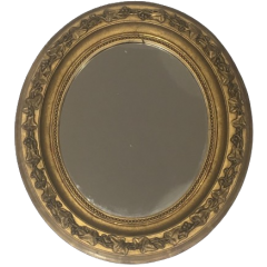 SMALL GILT STUCK OVAL MIRROR. FRENCH. CIRCA 1900