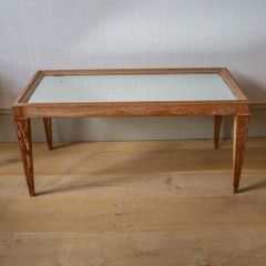 A mirror-topped coffee table