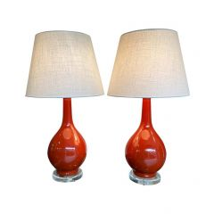 PAIR OF 1970S BURNT ORANGE CERAMIC LAMPS WITH LUCITE BASE AND BRASS FITTINGS