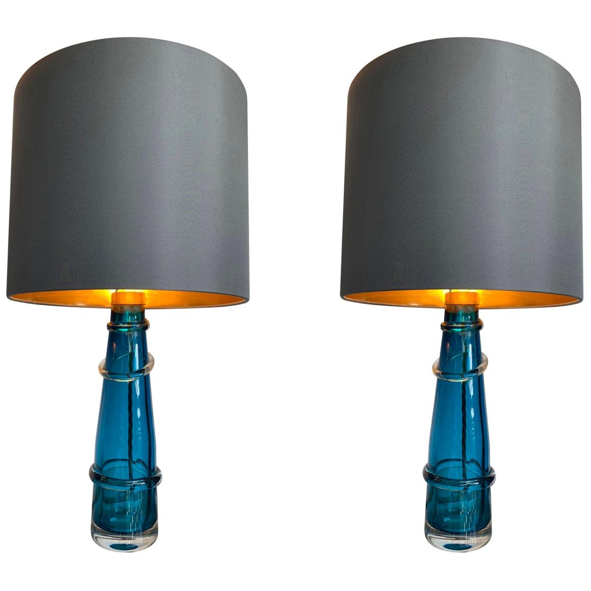 Picture of: Pair Of Orrefors Turquoise Glass Lamps With Brass Fittings And Bespoke Shades For Sale The Kairos Collective Uk