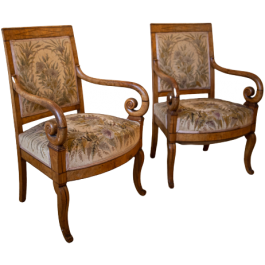 A trio of needlepoint upholstered elm armchairs