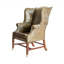 A Mahogany And Green Leather Wing Armchair