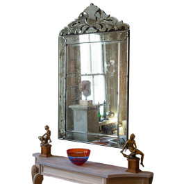 A large mirror with foliate cresting