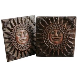 A pair of primitive carved sun panels