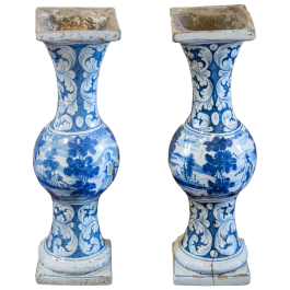A pair of early 18th century blue and white Delft balusters