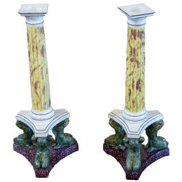 A pair of colourful faux marble glazed porcelain candlesticks