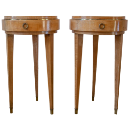 A pair of circular tripod side tables by Arbus