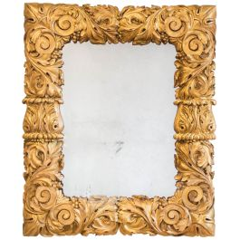 A Fine George Iv Rectangular Mirror With A Richly Carved Giltwood Cushion Frame