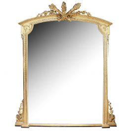 A monumental Carved and Giltwood Overmantle Mirror