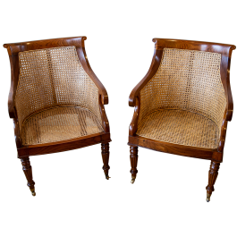 A pair of large caned plantation chairs