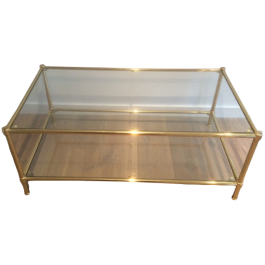 BRASS COFFEE TABLE WITH ROUND FEET. CIRCA 1960