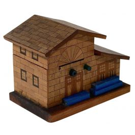 A Small Wooden Money Box In The Form Of A House
