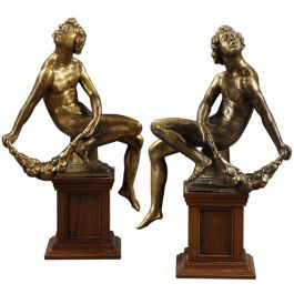 A set of four gilt bronze figures of seated nudes