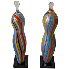 A pair of decorative glass balusters