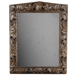 A mid 18th century large carved wooden frame, now as a mirror