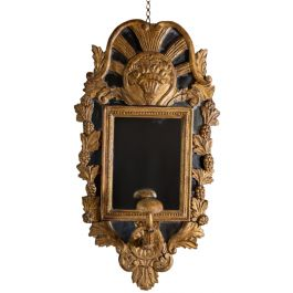 A continental carved giltwood mirror with turban holder