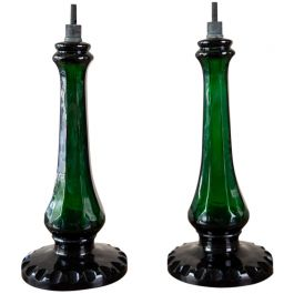 A pair of bottle green glass baluster lamps