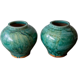 Back to view all Vases A pair of large vases with bold sea-green glaze