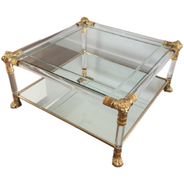 LUCITE AND GILT COFFEE TABLE WITH LION HEADS