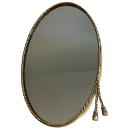 In the style of Maison Bagués. Oval Brass Mirror