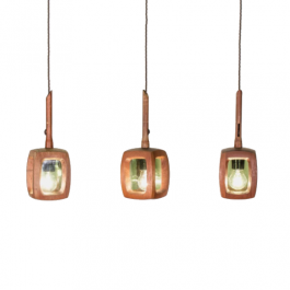 A set of three small teak and green glass lanterns