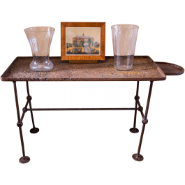 An industrial wrought iron table