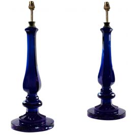 A pair of dark blue glass baluster lamps