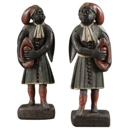 A pair of Dutch East Indian 18th century figures