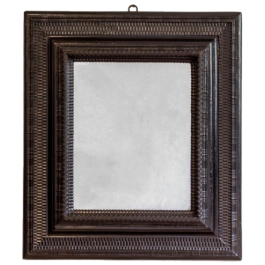A FINE RECTANGULAR EBONISED MIRROR