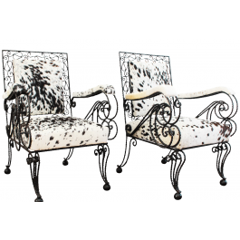 A Pair of 1950's Cowhide Wrought Iron Armchairs