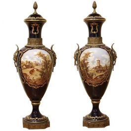 A Large Pair of Blue Royal Sevres Lidded Vases with Hand Painted Scene
