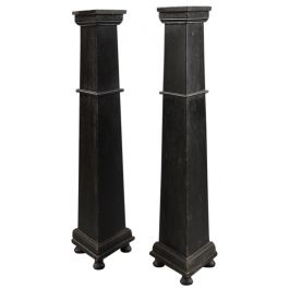 A pair of black painted tapering pedestals