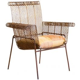 A Perforated Metal Armchair In The Manner Of Mathieu Mategot (1910 - 2001)