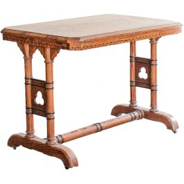 A REFORMED GOTHIC RECTANGULAR PITCH PINE OCCASIONAL TABLE IN THE MANNER OF CHARLES BEVAN