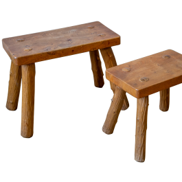 Two rustic stools with carved bark legs