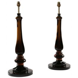 A pair of cognac glass baluster lamps