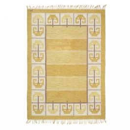 A Hand-Woven Flatweave Rug Woven In Tones Of Yellow And Ochre