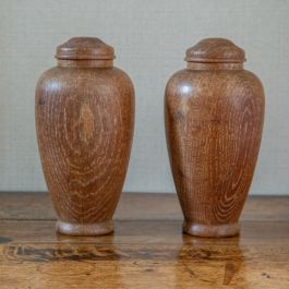 A pair of wooden balusters