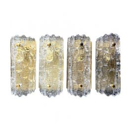 A PAIR OF ORREFORS GLASS WALL SCONCES WITH BRASS PLATES BY CARL FAGERLUND